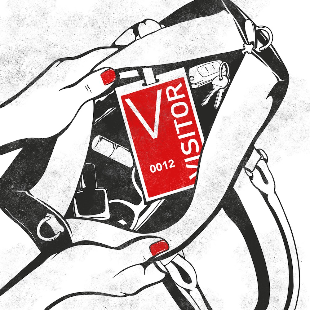 Visitor badge in a purse